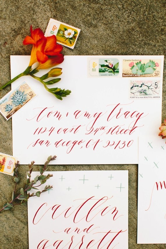 Red calligraphed invites