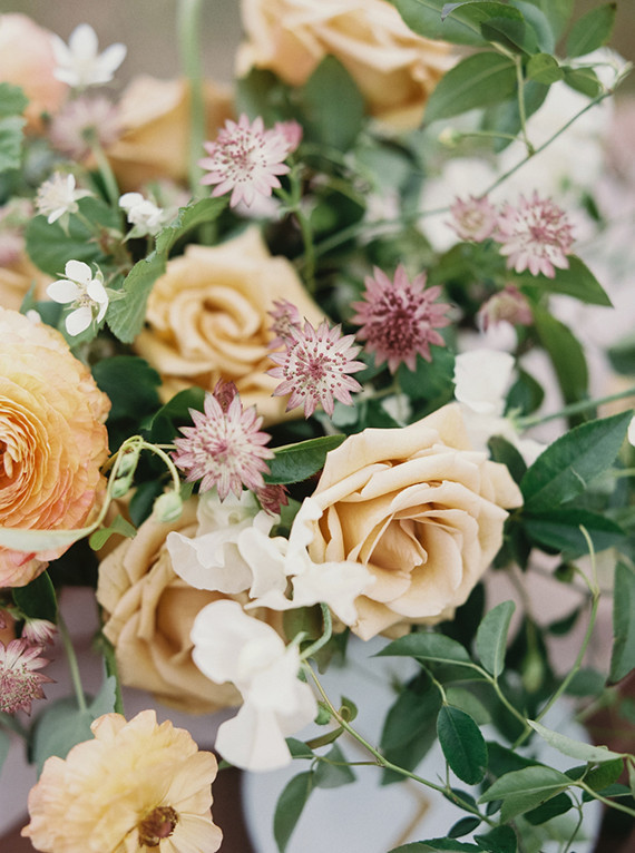 Rose and ranunculus floral centerpiece