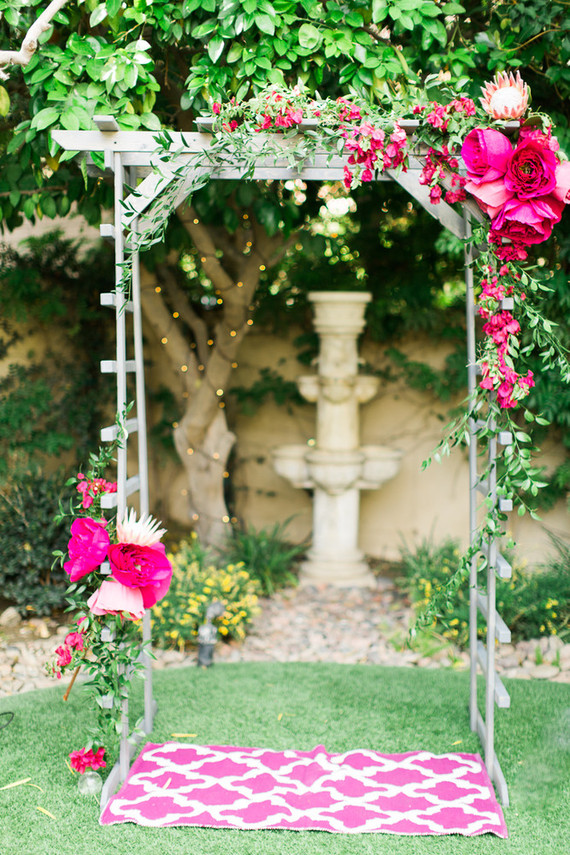 Paper flower wedding arbor