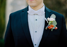 Colorful boutonniere and bow tie