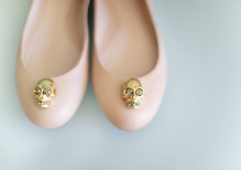 Pink flats with gold skull