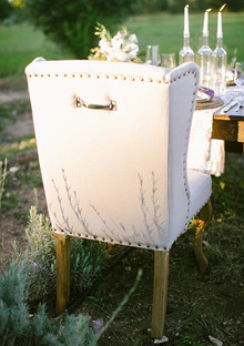 White and gold studded chair