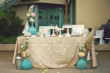 Gold sequin dessert table
