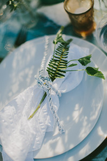 White napkin with green leaf
