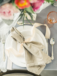 Cream napkin with ribbon