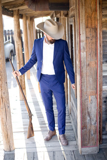 Groom in bright blue suit
