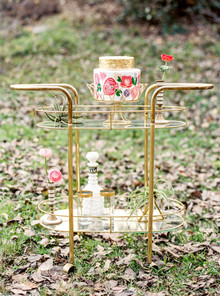 Gold bar cart with cake