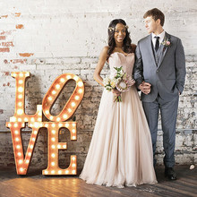 Industrial Wedding Portrait with Marquee Sign