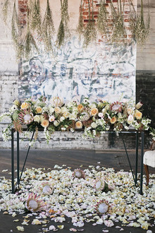 Industrial Wedding Sweetheart Table Protea Decor