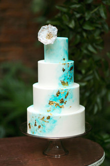 White, gold and blue modern wedding cake