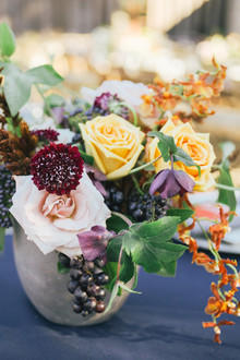 Grape and rose floral arrangement