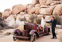 Bohemian desert portrait with vintage car