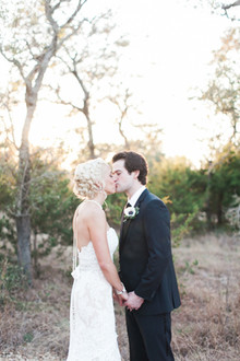 Kissing outdoor wedding portrait
