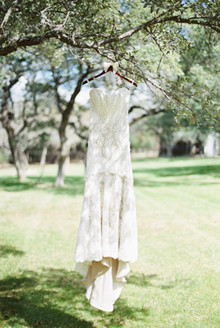 Wedding dress hanging from tree