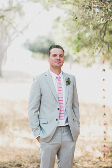 Groom with grey suit and pink tie