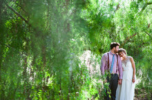 Outdoor greenery wedding portrait
