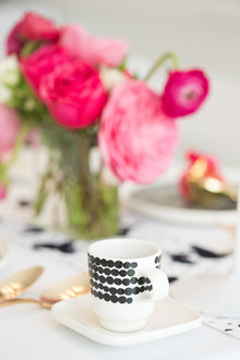 Black and white polka dot teacup
