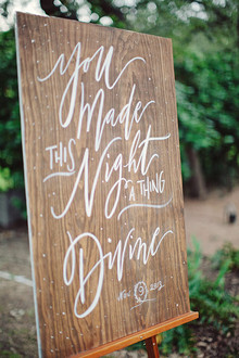 Wood signage with white calligraphy