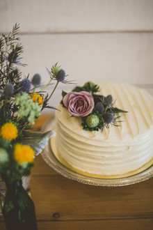Rustic cake with flower topper