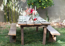 Backyard dinner party wooden tablescape
