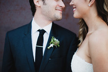 Boutonniere and wedding portrait