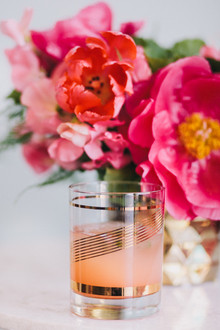 Gold glassware with peach cocktail