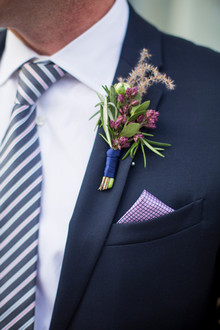 Purple and blue boutonnière