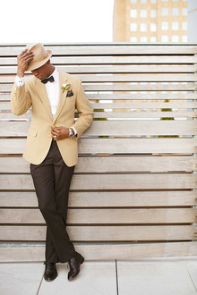 Groom in fashionable creme blazer