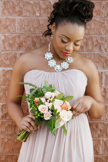 Pink bridesmaid gown with statement necklace