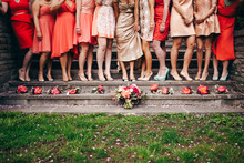 Pink and red bridesmaid with bouquets