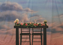 Sky backdrop with wooden tablescape