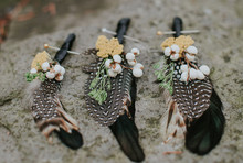 Feather boutonnieres
