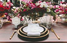 Modern black and gold place setting