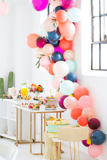 dessert table with balloons