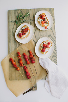 Grilled tomato skewers on toast