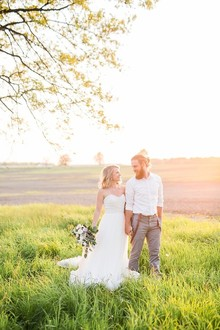sunset wedding photos in a field