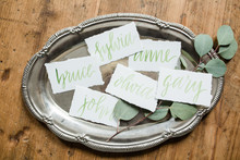 green calligraphy place cards