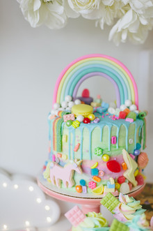messy rainbow birthday cake