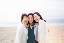 multi generation family photos at the beach