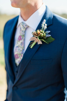 Floral tie and boutonniere