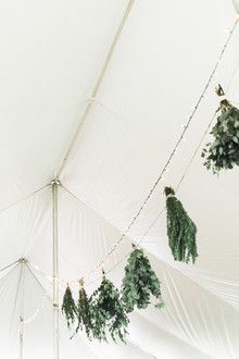 hanging bunches of herbs in wedding decor