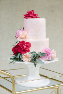 pink wedding cake with peonies