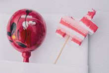 maraca and mini piñata wedding favors