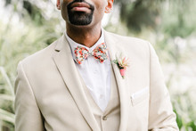 Groom with khaki suit and floral bowtie