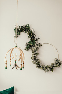 Gender neutral gold and emerald boho nursery