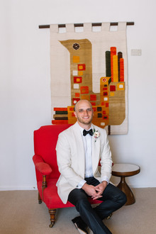 Groom in white tux jacket
