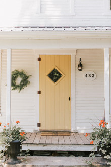 simple fall porch with a yellow door