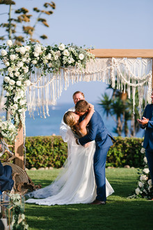 Modern beachy macrame ceremony backdrop