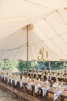 rustic wedding tent with hand-dyed napkins and pampas grass wreaths