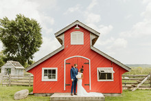 Farm to table summer wedding with pops of red and a PARADE